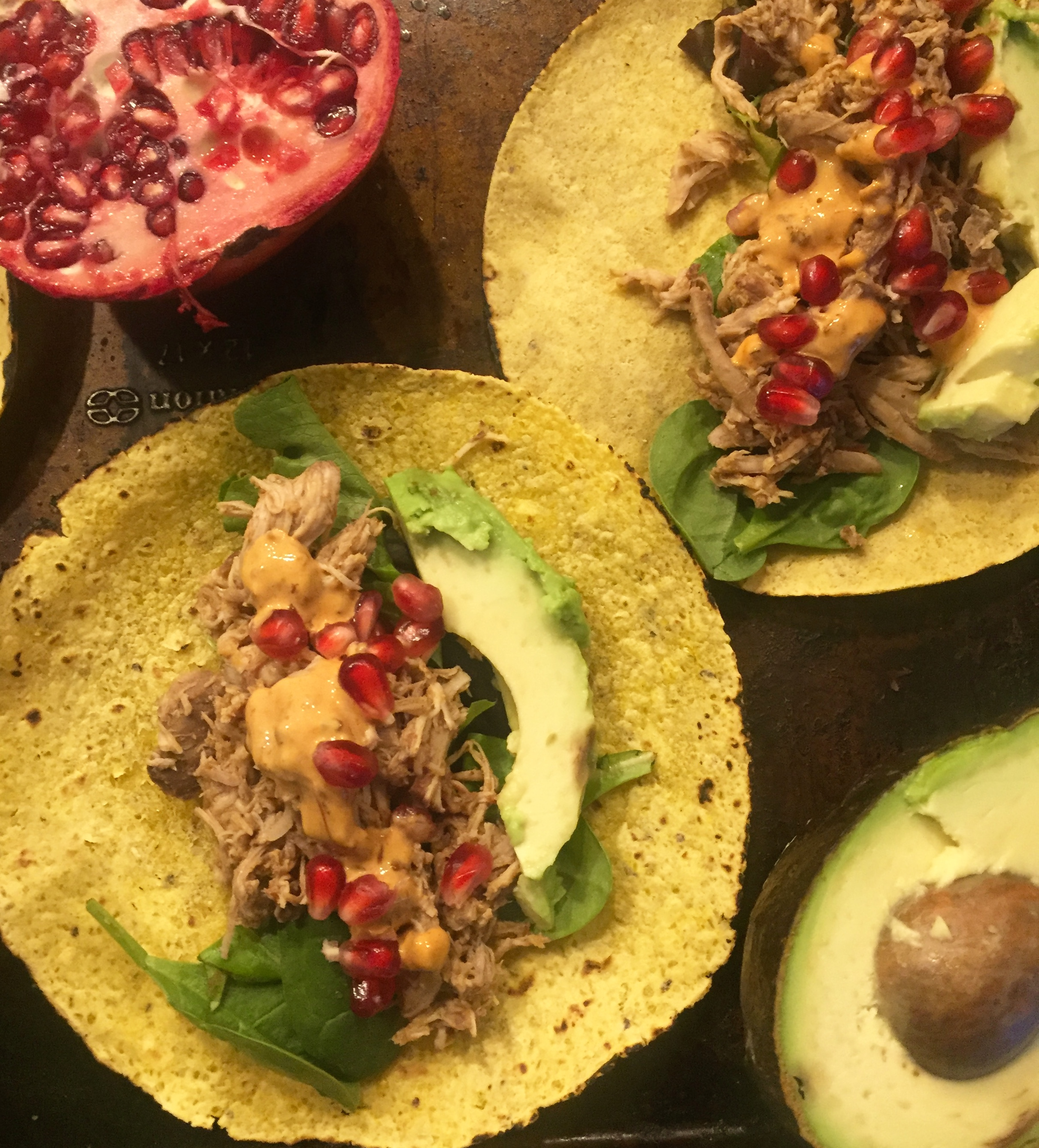 Pomegranate slow-cooker chicken tacos with toppings