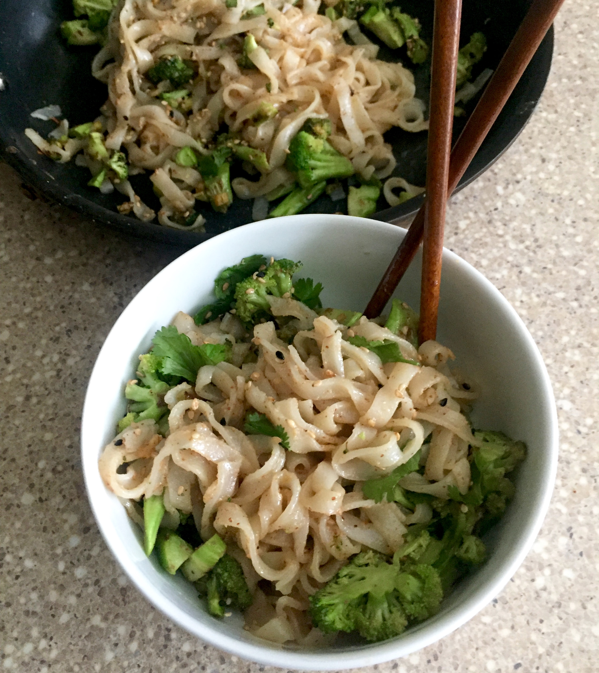Almond butter vegetable stir fry with Thai rice noodles and skilet